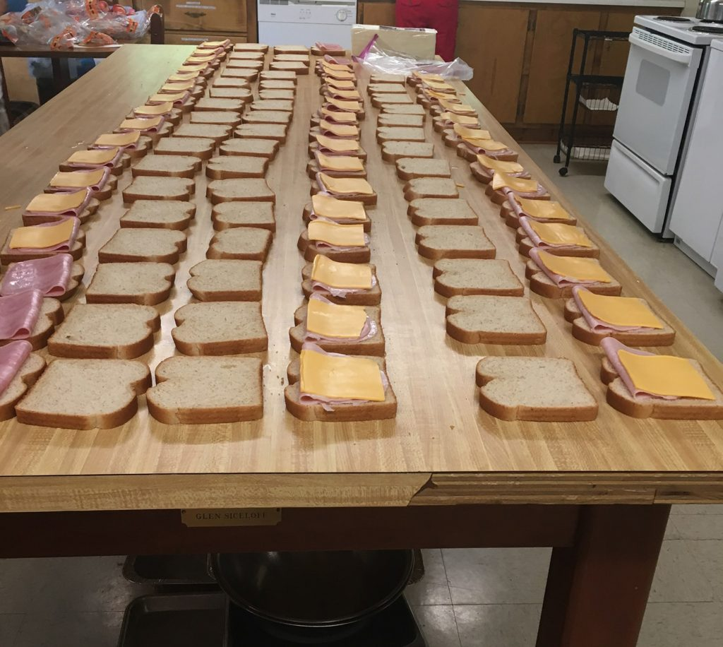 Making sandwiches for From His Hands